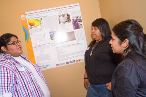 Hilario Pio-Martinez and Victoria Chavez, two students from the Tohono O'odham Community College during a poster presentation