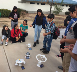Students build amusement parks powered by solar panels.